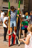 Boy On Wooden Stilts