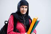 Arab Student Holding Folders