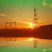Construction of the bridge and electric cable line. Sunset image.