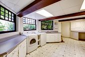 picture of basement  - Spacious laundry area in basement with brown trim - JPG
