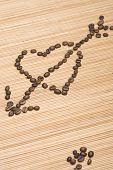 Coffee heart pierced by an arrow