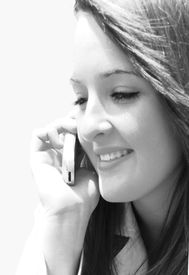 image of long distance  - beautiful young women on cell phone in black and white - JPG