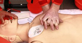 stock photo of resuscitation  - resuscitation performed by health care professionals to dummy - JPG