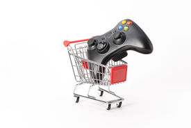 foto of caddy  - Caddy for shopping with game pad on white background - JPG