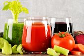 Glasses With Fresh Organic Vegetable Juices On Wooden Table