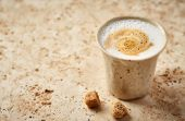 Latte coffee in a rustic ceramic mug
