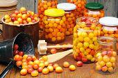 Preserving Mirabelle plums - jars of homemade fruit preserves - Mirabelle prune