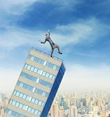 Businesswoman on the falling builging