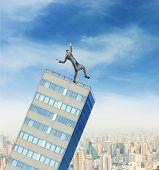 Businesswoman on the falling builging