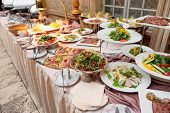 image of catering  - Catering table full of food - JPG