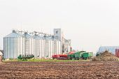 Farm Grain Storage Bins. Outdoors.