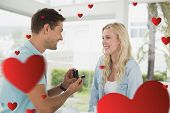 foto of marriage proposal  - Man proposing marriage to his blonde girlfriend against hearts - JPG