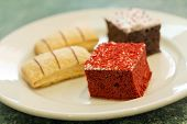 stock photo of jimmy  - Assortment of sweet and colorful dessert cakes on a plate - JPG