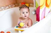 toddler boy taking a bath