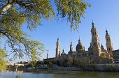 View of the  basilica of the Virgen del Pilar and Ebro river, the bottom is situated the medieval bridge called Puente de Piedra, Zaragoza, Aragon, Spain