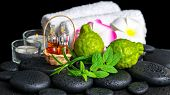 Aromatic Spa Setting Of Bergamot Fruits, Fresh Mint, Rosemary, Candles, Towels, Flower And Bottles E