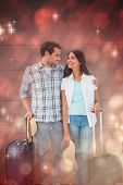 Attractive young couple going on their holidays against light design shimmering on red
