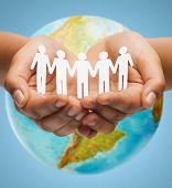 Постер, плакат: people geography population and peace concept close up of human hands with earth globe showing a