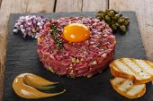 image of tartar  - Beef tartare with capers and onions yolk with mustard