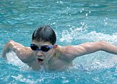 Boy swimming butterfly