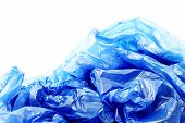 Blue plastic garbage bags on white