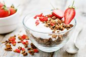 Fresh Breakfast Of Granola, Yogurt, Nuts, Goji Berries And Strawberries
