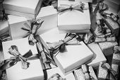 picture of piles  - Black and white image of gifts pile with ribbons - JPG