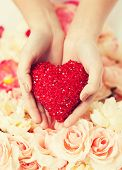 close up of woman's hands holding heart
