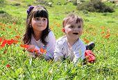 Happy Children Lie On A Meadow