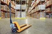 picture of pallet  - Manual forklift pallet stacker truck equipment at warehouse - JPG