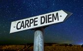 Carpe Diem sign with a beautiful night background