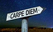 Carpe Diem sign with a beautiful night background