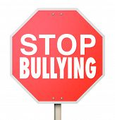 Stop Bulling words on a red road or street sign to prevent children from picking on, fighting or being mean to other kids