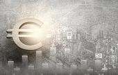 Euro currency sign against modern city background