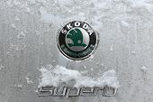 PRAGUE, CZECH REPUBLIC - JANUARY 18, 2013: Snow covered emblem of Skoda Superb car seen in Prague, Czech Republic.