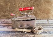 Retro Still Life With Old Rusty Iron ,paper Roll And Rope Reel On A Wooden Table