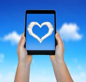 Photo of heart from clouds in a tablet