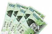 foto of won  - Several Korean 10000 Won currency bills isolated on a white background - JPG