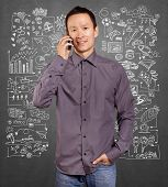 Asian man smiling talking on the cell, choosing between family, relations, hobbies, work and sport, on sketch background