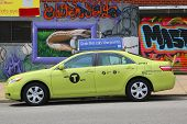 New green-colored Boro taxi in Astoria section of Queens