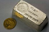 image of indian currency  - Old silver bullion bar and 1911 United States five dollar Indian Head gold coin
