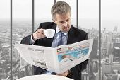 Businessman reading a newspaper, office backgrounds