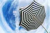 Striped  Beach Umbrella Over Blue Sky Fish Eye Bottom View