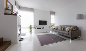 picture of taupe  - White living room with taupe leather sofa and glass table - JPG