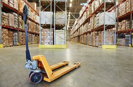 stock photo of forklift  - Manual forklift pallet stacker truck equipment at warehouse - JPG