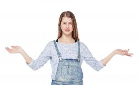pic of annoying  - Annoyed young fashion girl in jeans overalls isolated on white background - JPG
