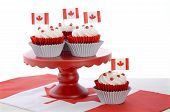 foto of flag confederate  - Happy Canada Day celebration cupcakes with red and white maple leaf flag on red cake stand against a white background - JPG