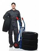 Man With Handtruck And Tires