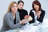 stock photo of real-estate-team  - three women working together in an estate agency - JPG
