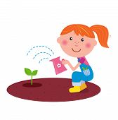 Small gardener girl watering plant in the garden